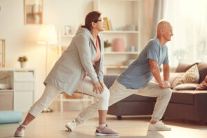 older couple exercising to maintain healthy legs