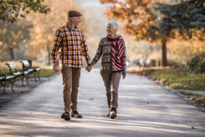 Image of couple walking for an article about healthy leg tips