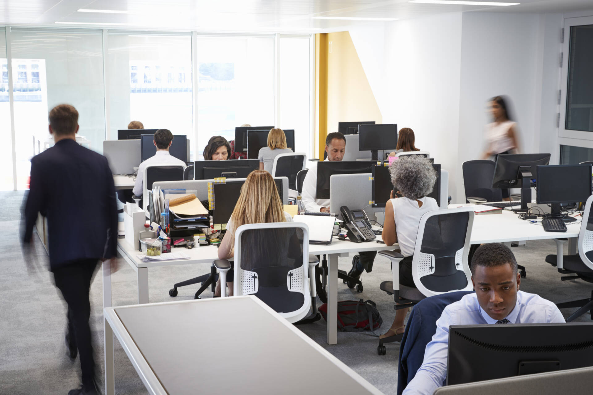 image of office workers for blog about the harm in sitting